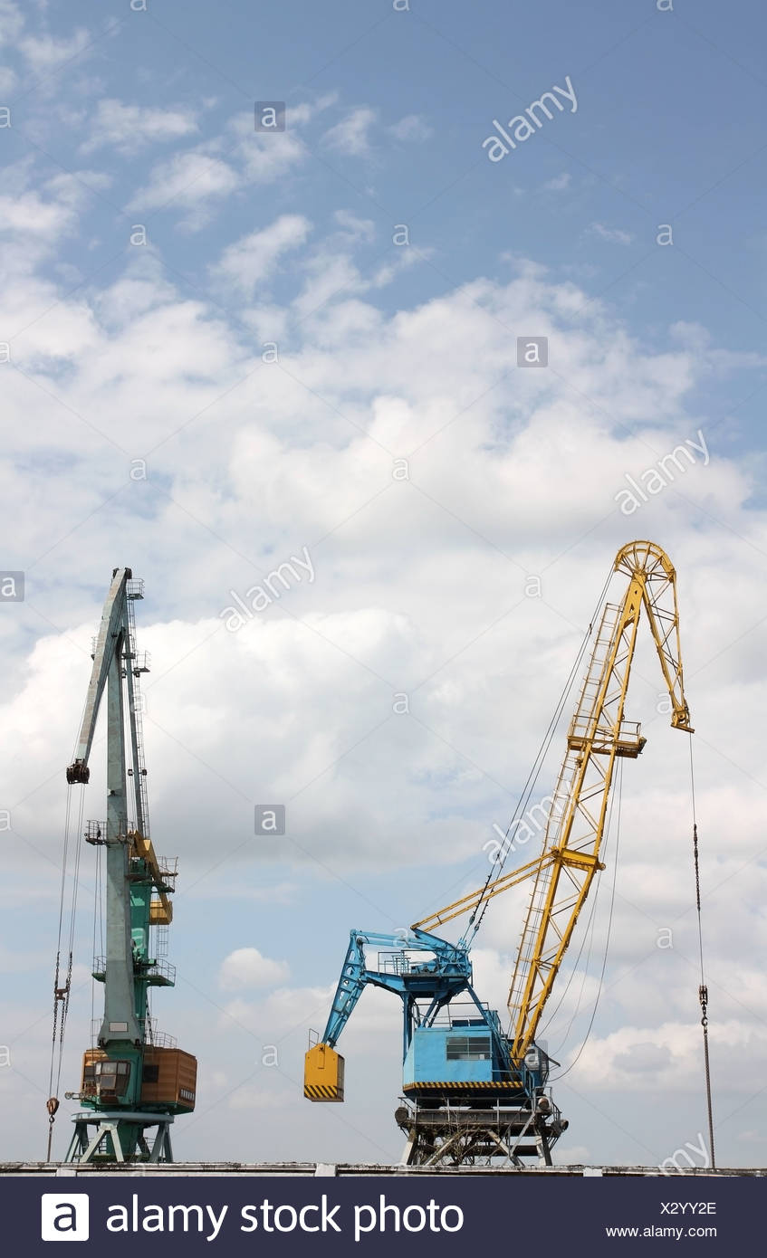 Two elevating cranes - Stock Image