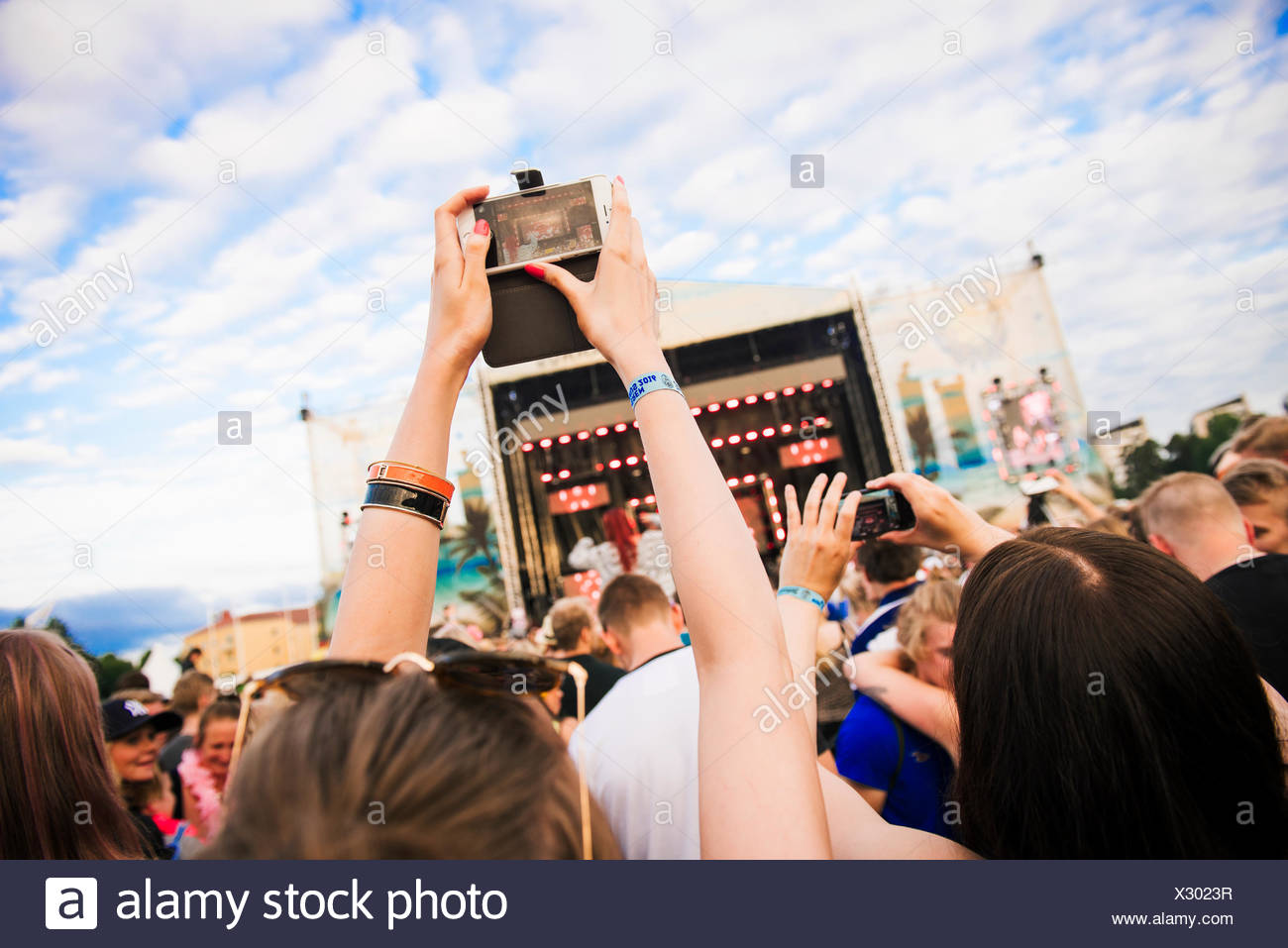 Finland, Satakunta, Rauma, People having fun at pop concert - Stock Image
