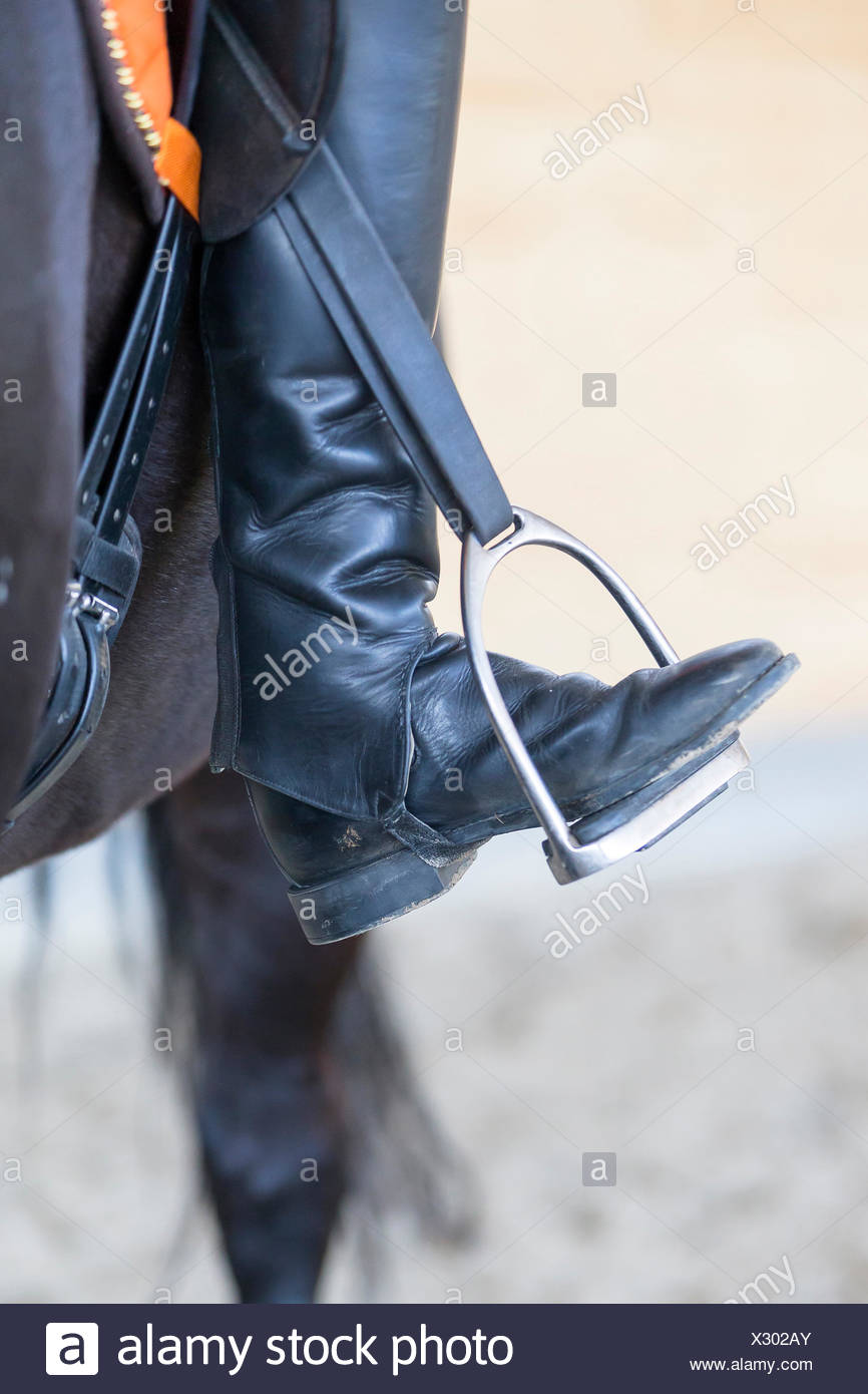 Horseback riding Toes turned to far out - Stock Image