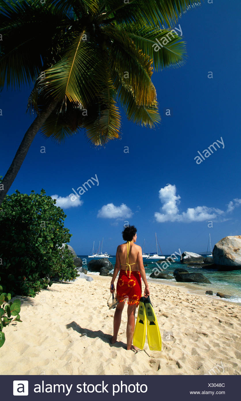 Woman in front of The Baths, a rock formation on Virgin Gorda Island, British Virgin Islands, Caribbean - Stock Image