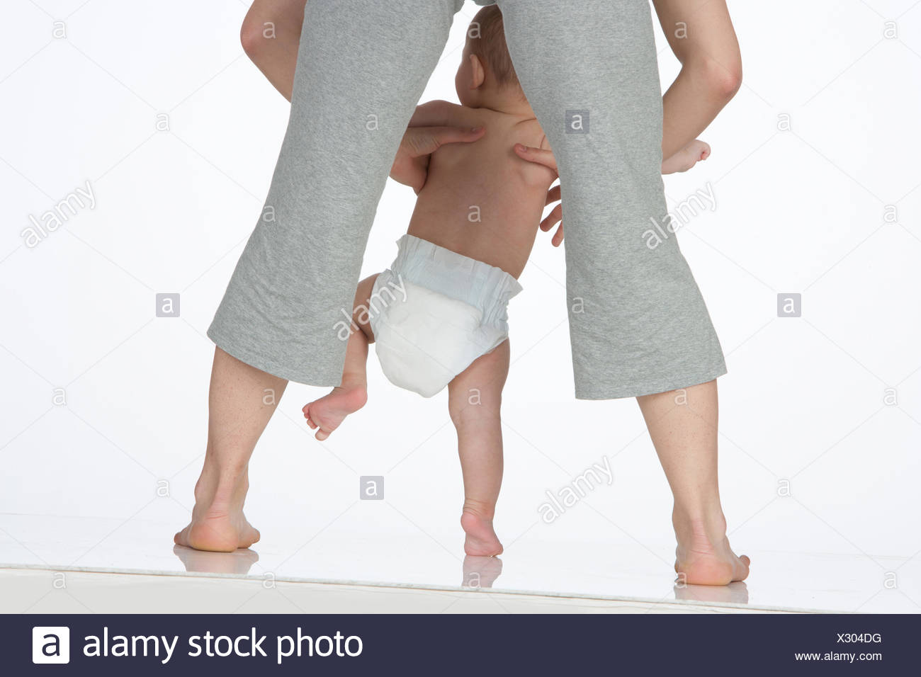 A woman holding a baby - Stock Image