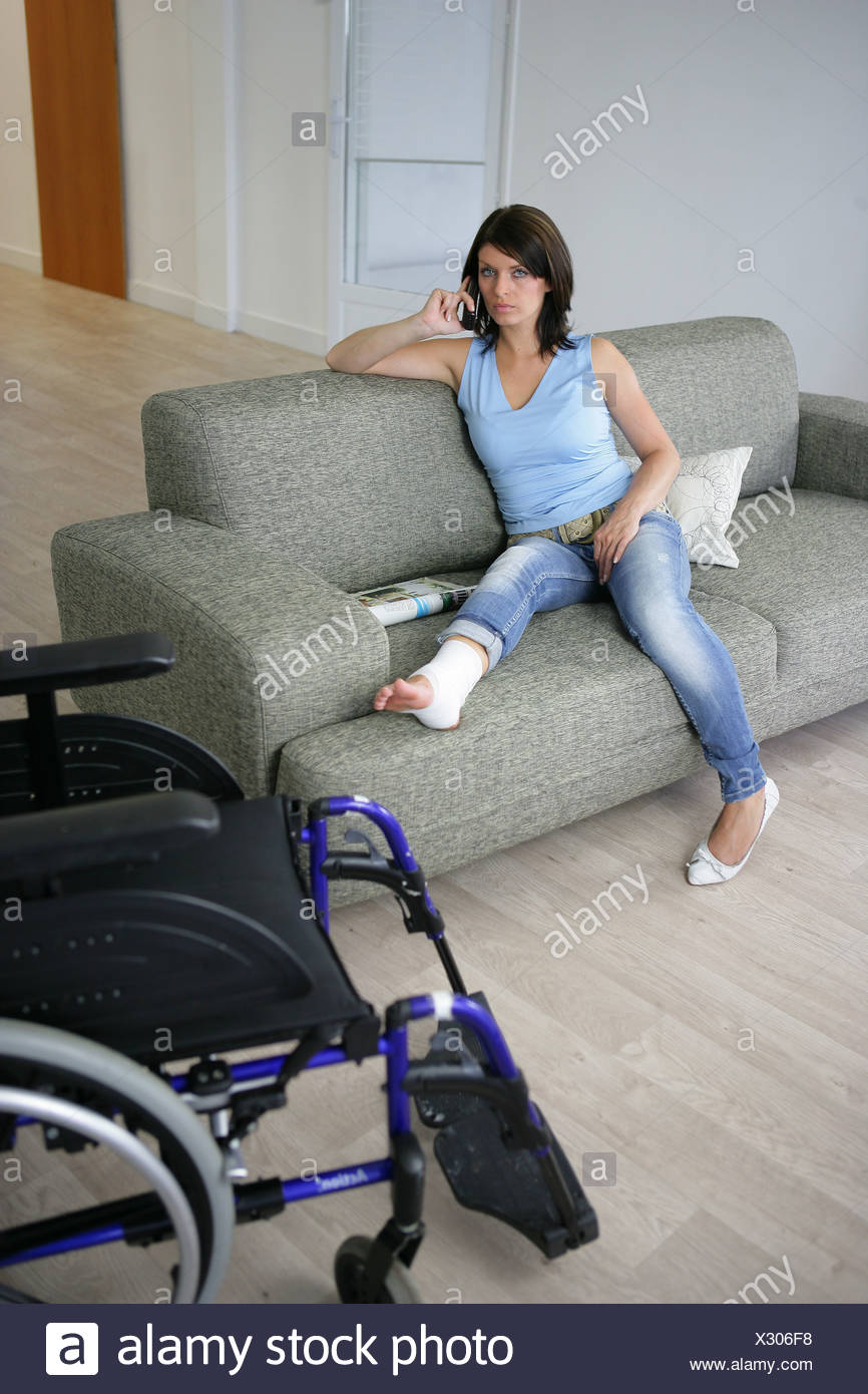 Woman with her leg in a cast Stock Photo