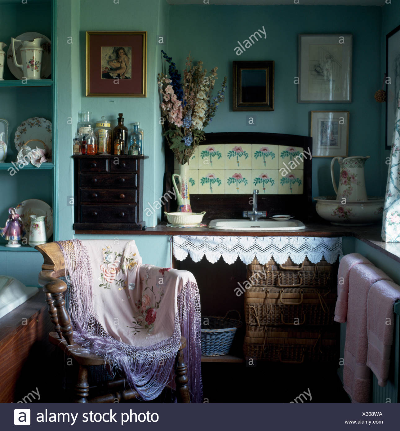 Vintage Shawl On Wooden Chair In A Pale Turquoise Victorian Style Cottage Bathroom With Old Picnic
