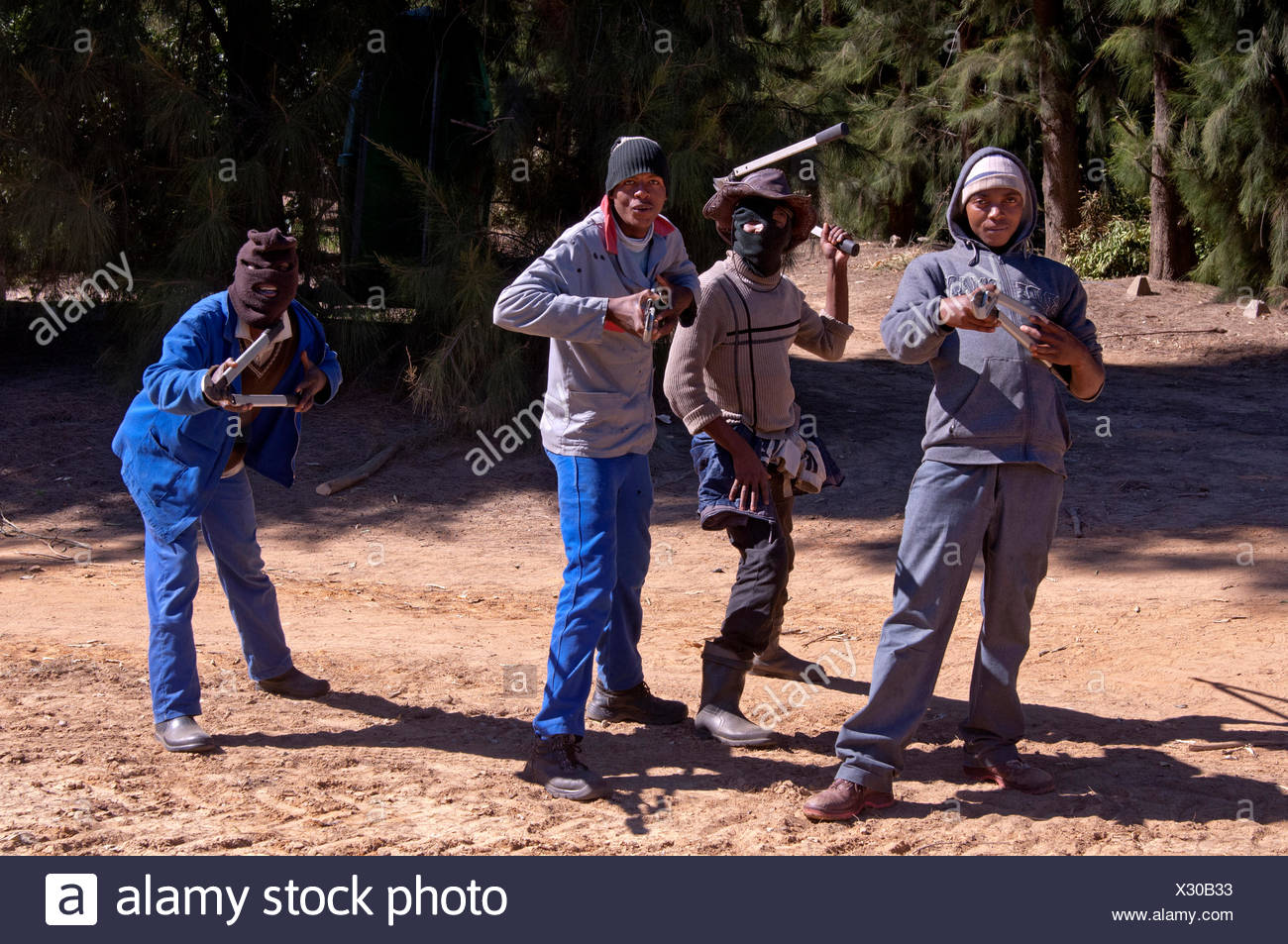 Partially masked men armed with tools in a threatening posture, Clanwilliam, Western Cape Province, South Africa, Africa - Stock Image