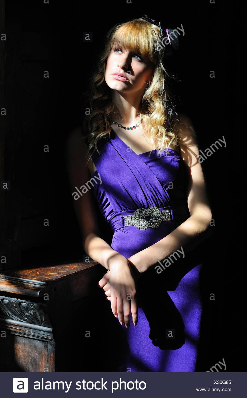 Girl In Sun Rays. - Stock Image