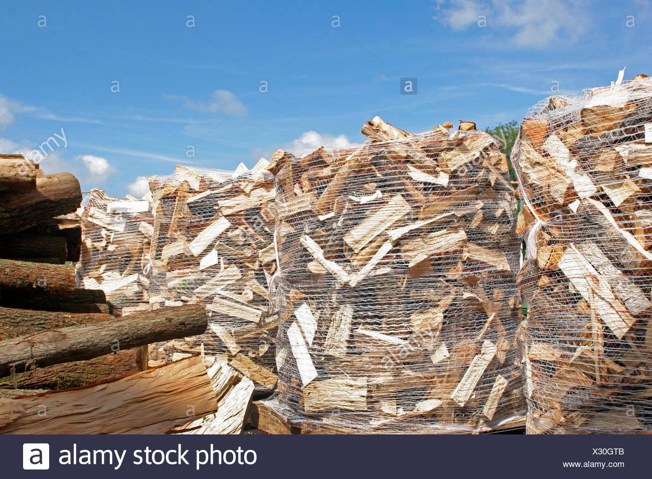 firewood working, storage area with sacks of firewood, Germany - Stock Image