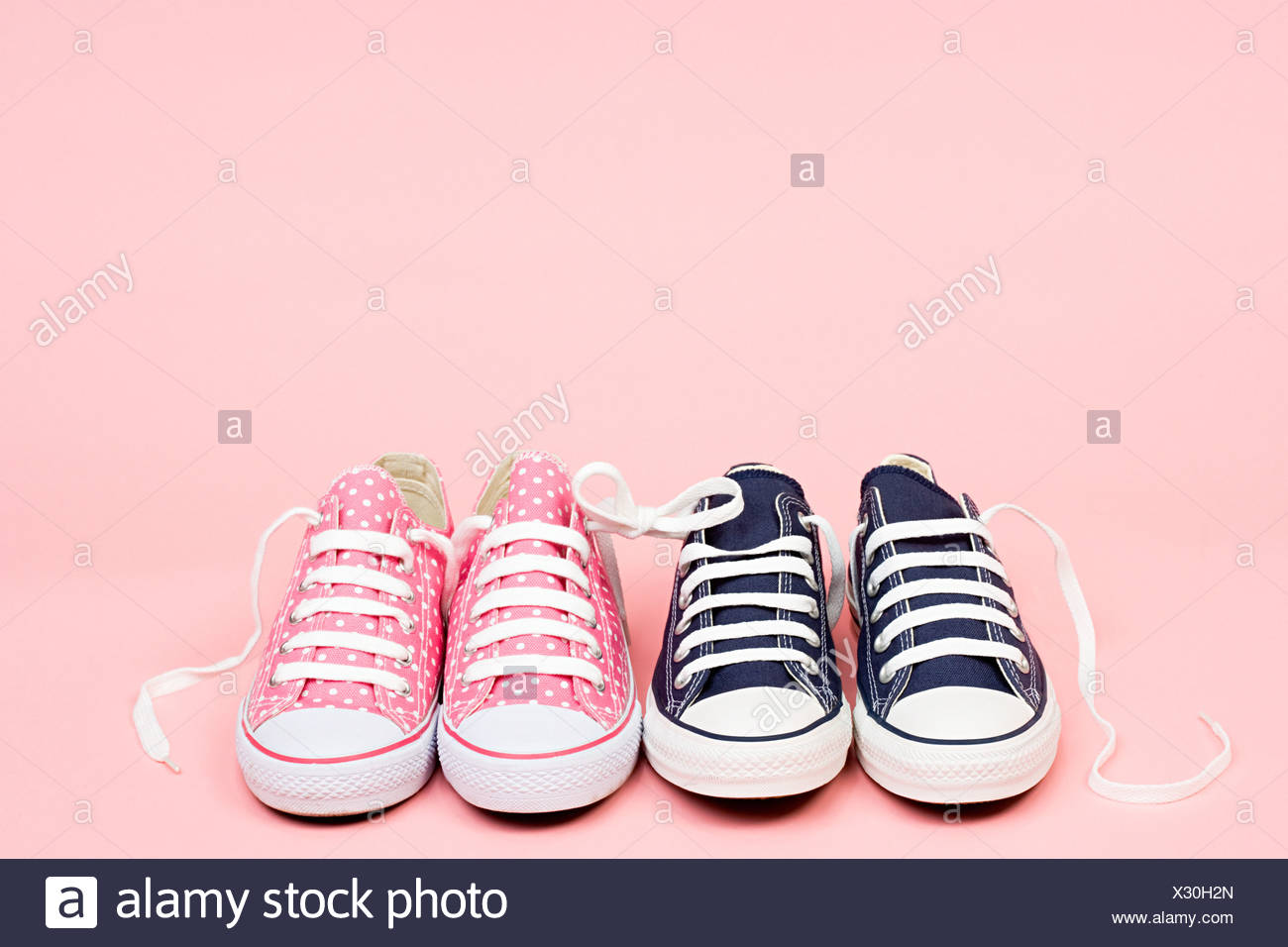 Trainers in a row - Stock Image