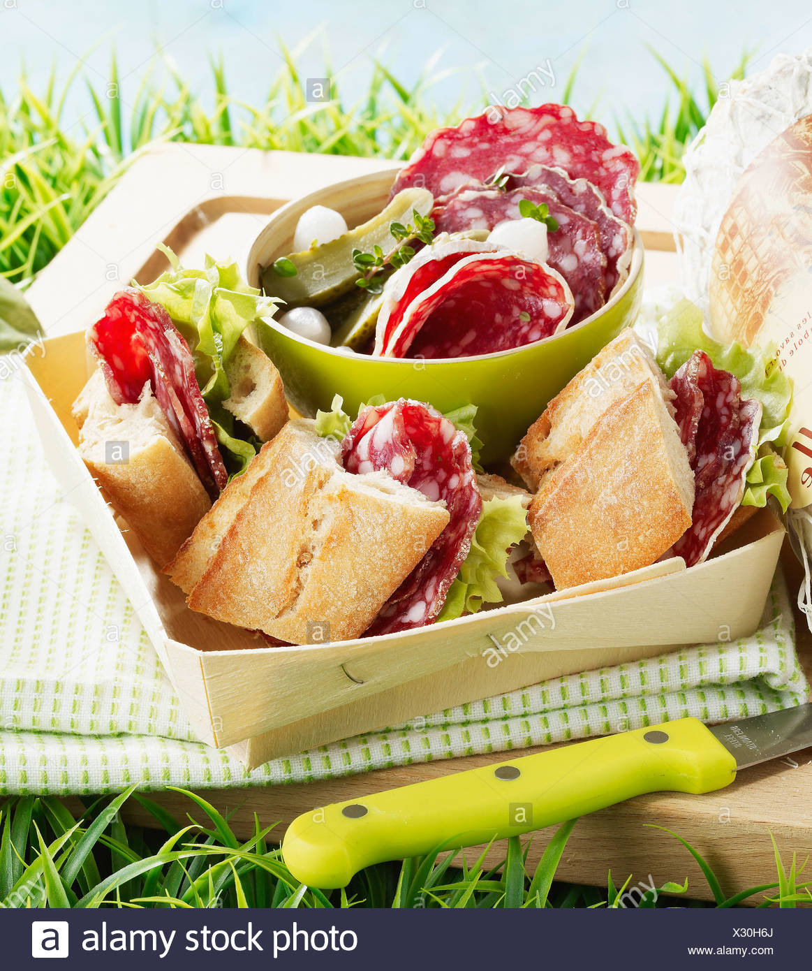 Picnic with dried sausage sandwiches - Stock Image