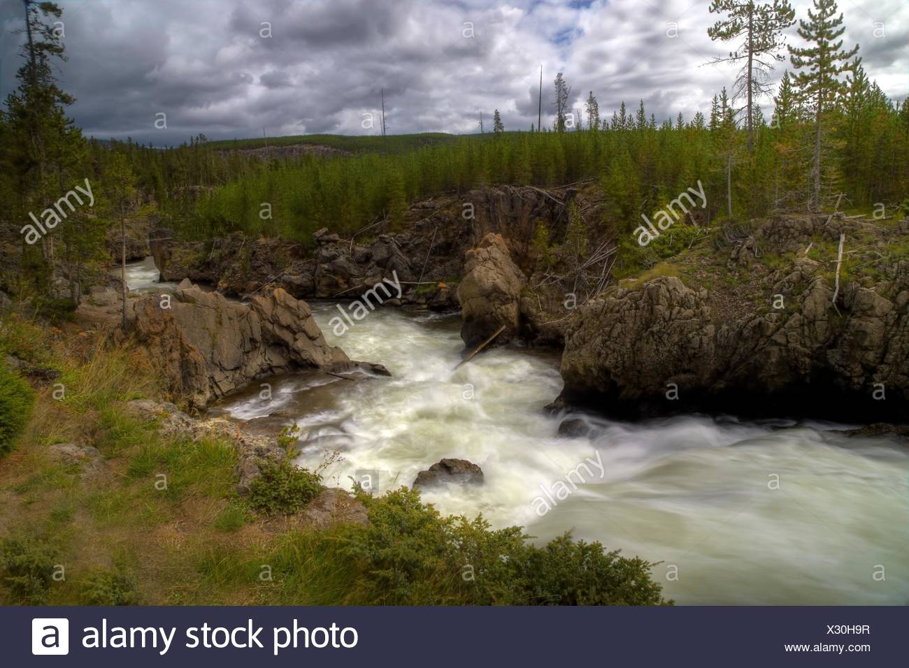 The Firehole River roars through Firehole Canyon at Yellowstone National Park, Wyoming. - Stock Image