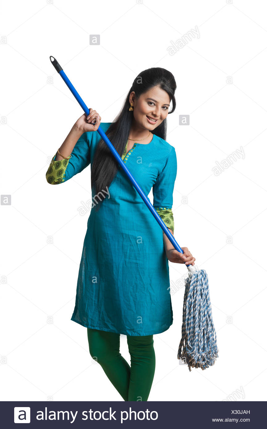 Woman holding a mop as a guitar - Stock Image