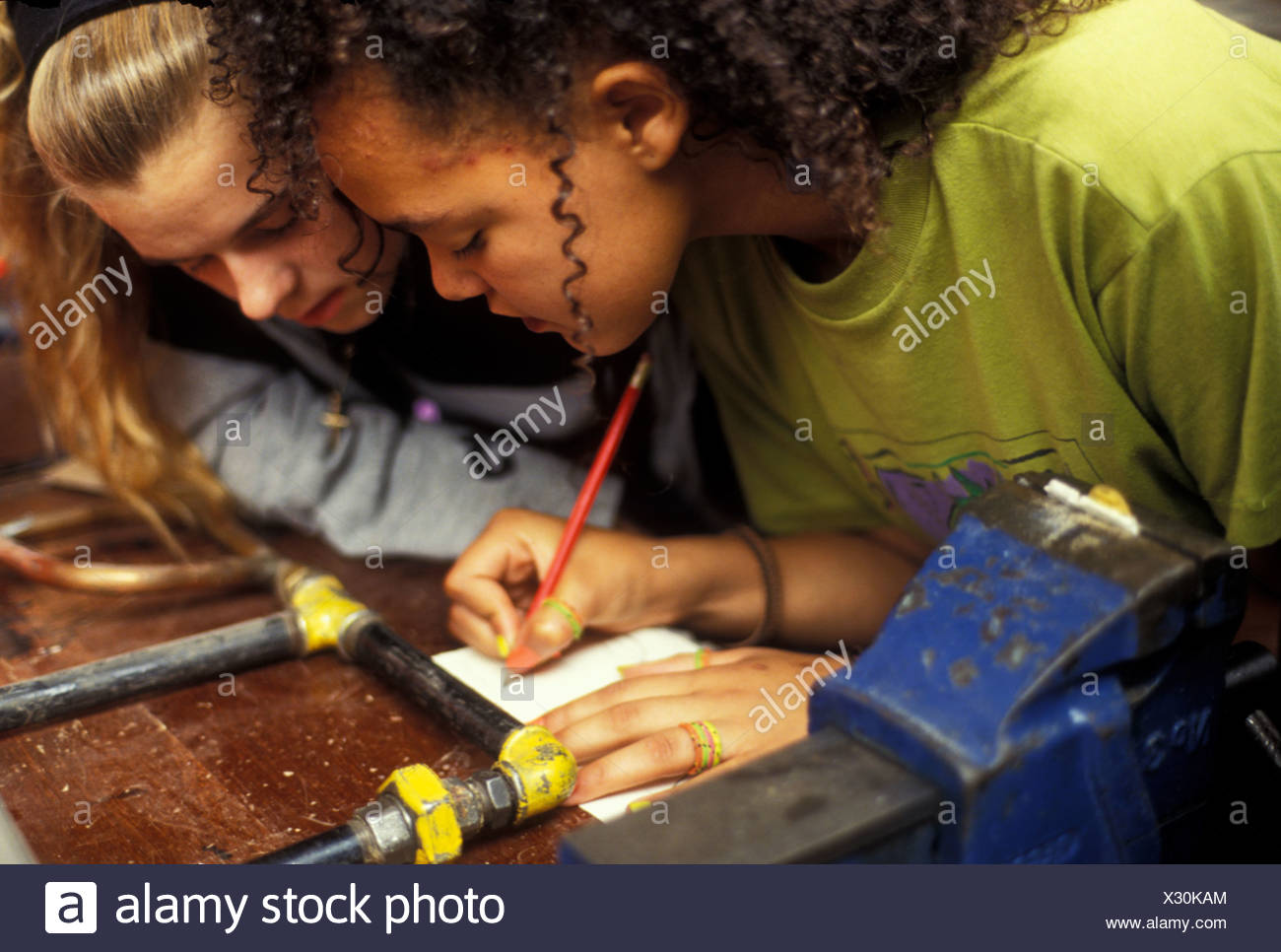Girls doing metalwork in CDT class at Secondary school - Stock Image