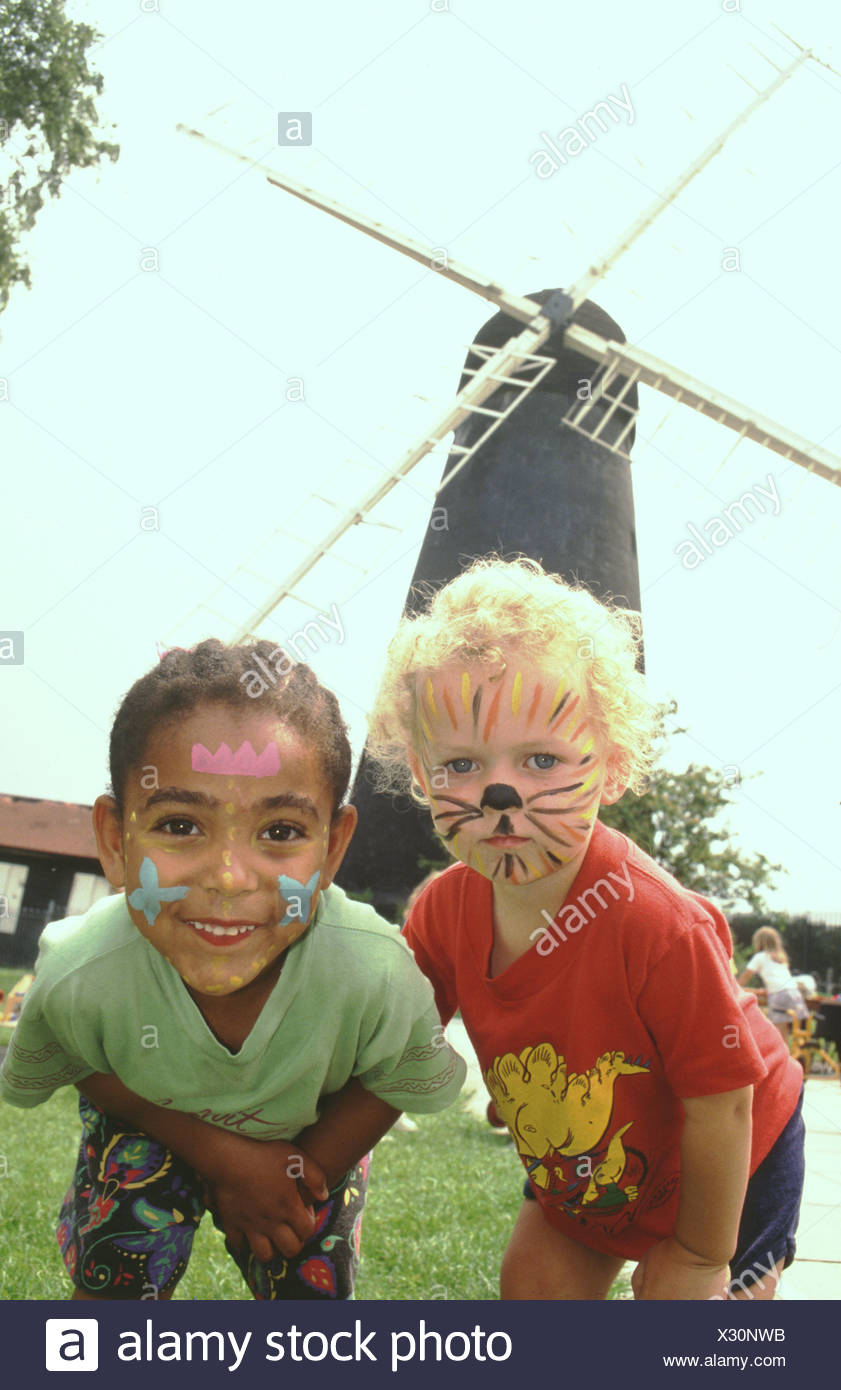 Small children with painted faces playgroup in front of Brixton windmill London UK - Stock Image