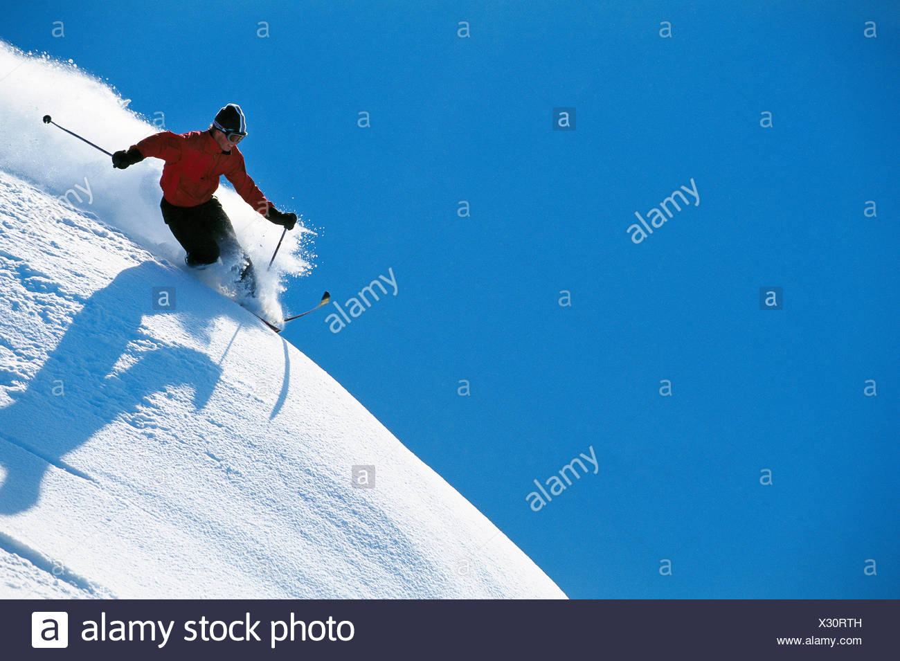 30-34 years activity adults only adventure blue clear sky color image courage downhill skiing horizontal leisure lifestyle - Stock Image