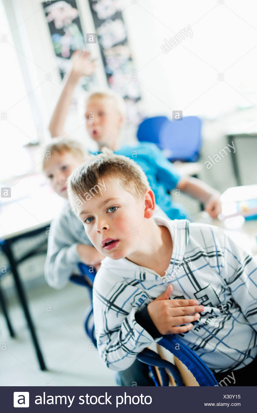Three person in class - Stock Image