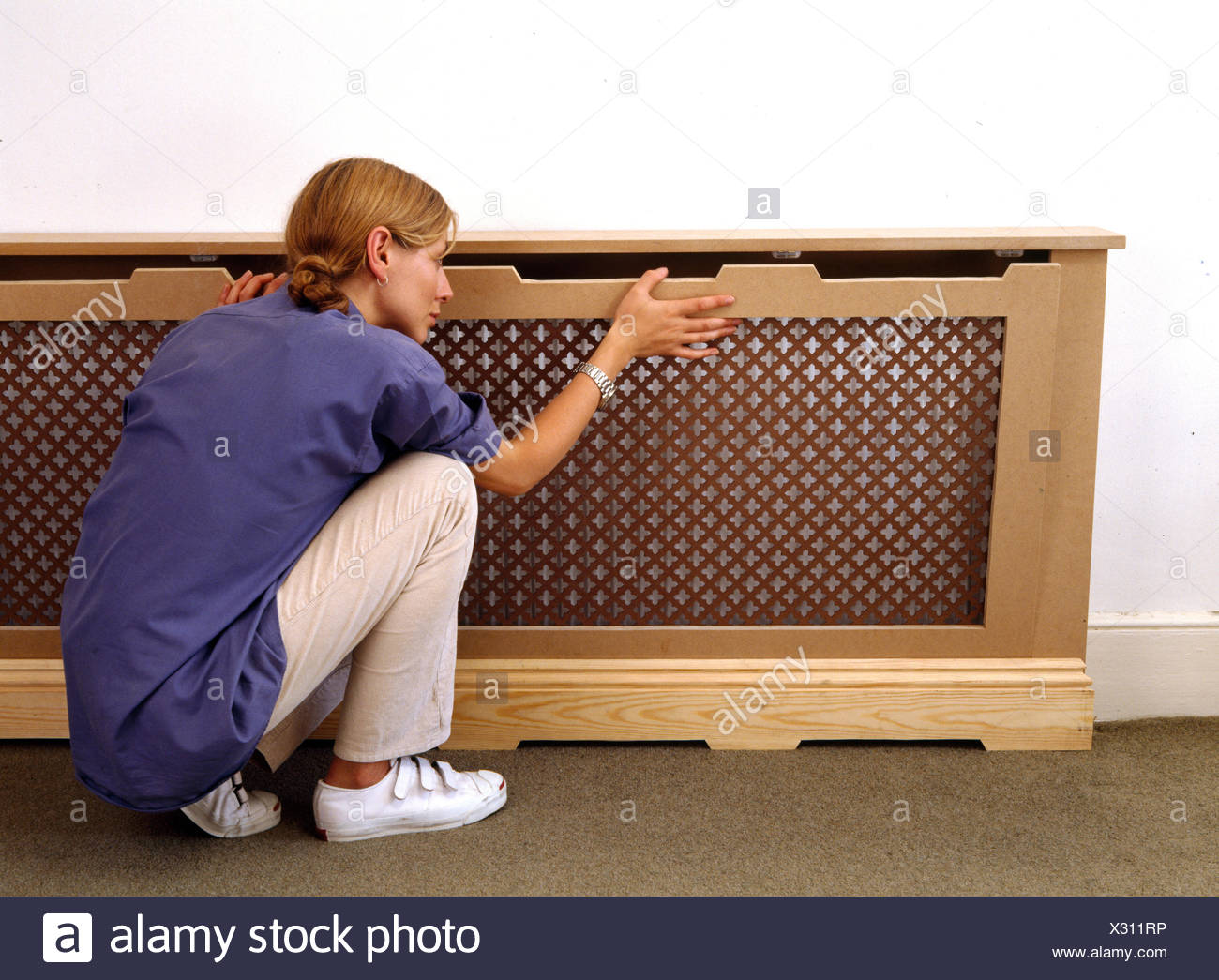 Fitting A Radiator Cover High Resolution Stock Photography And Images Alamy