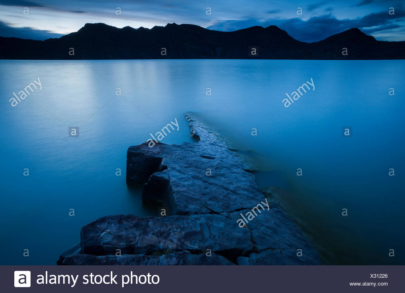 A long exposure along the shore of Lago Nordenskjöld in Torres del Paine. - Stock Image