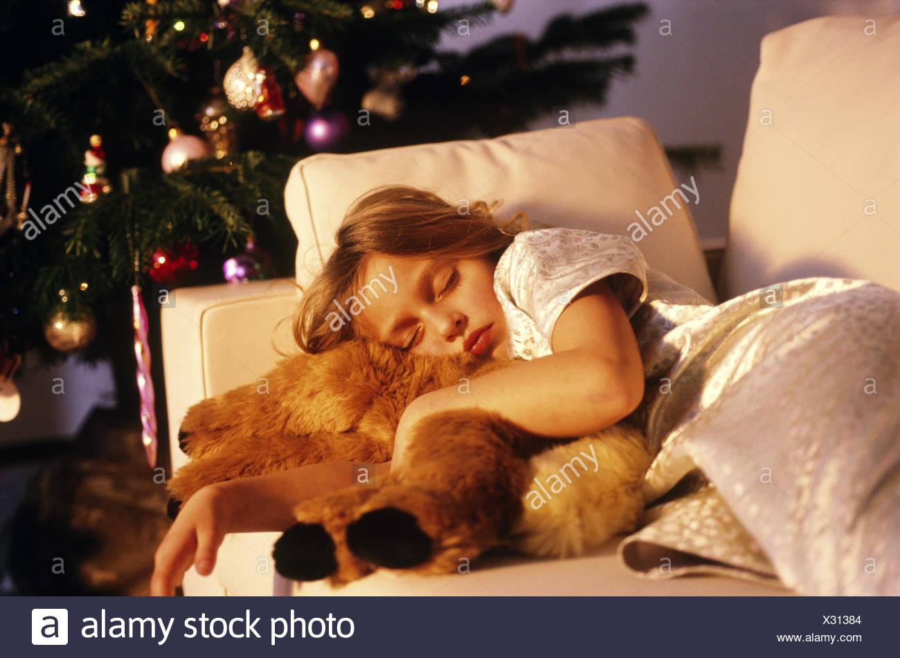 Young girl sleeping at Christmastime - Stock Image