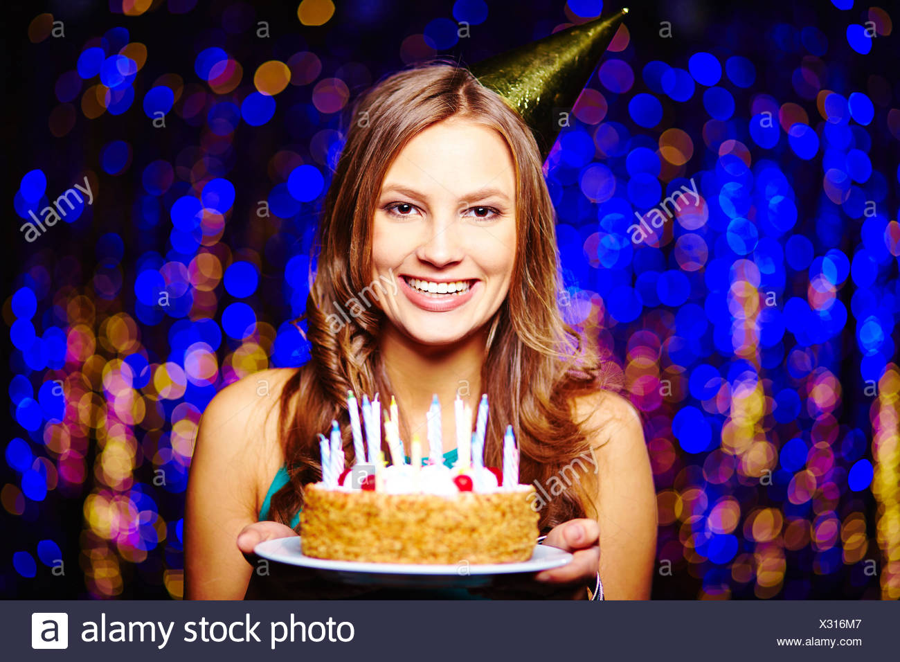 Miraculous Smiling Girl With Birthday Cake Looking At Camera On Sparkling Funny Birthday Cards Online Aboleapandamsfinfo