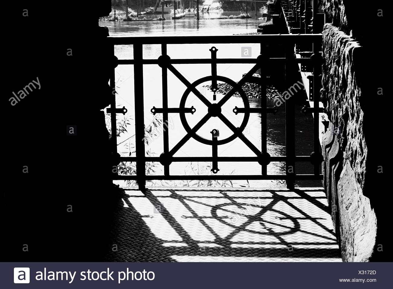 Metal Grate Against Elbe River On Sunny Day - Stock Image