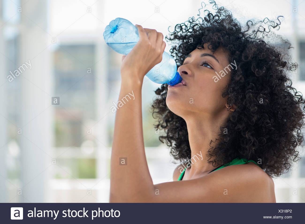 Close-up of a woman drinking water from a bottle - Stock Image