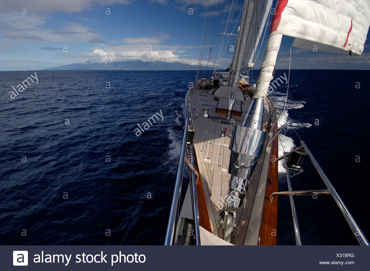 Dramatic photo taken from the bow of SY 'Adele', 180 foot Hoek Design, sailing in French Polynesia, 2006.  Non editorial uses mu - Stock Image