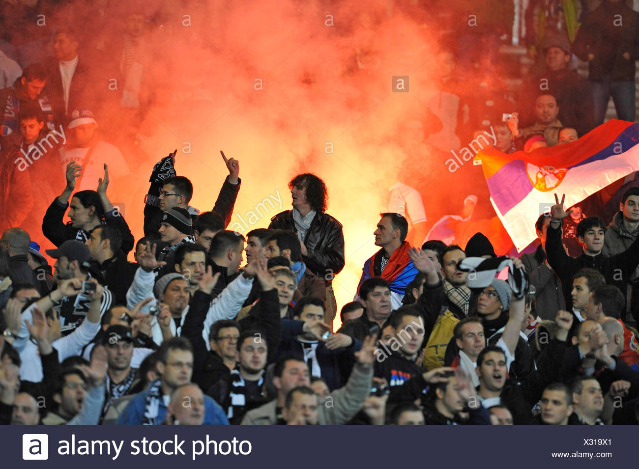 Hooligans lighting a bengali fire in the fanblock, Mercedes-Benz Arena, Stuttgart, Baden-Wuerttemberg, Germany, Europe - Stock Image