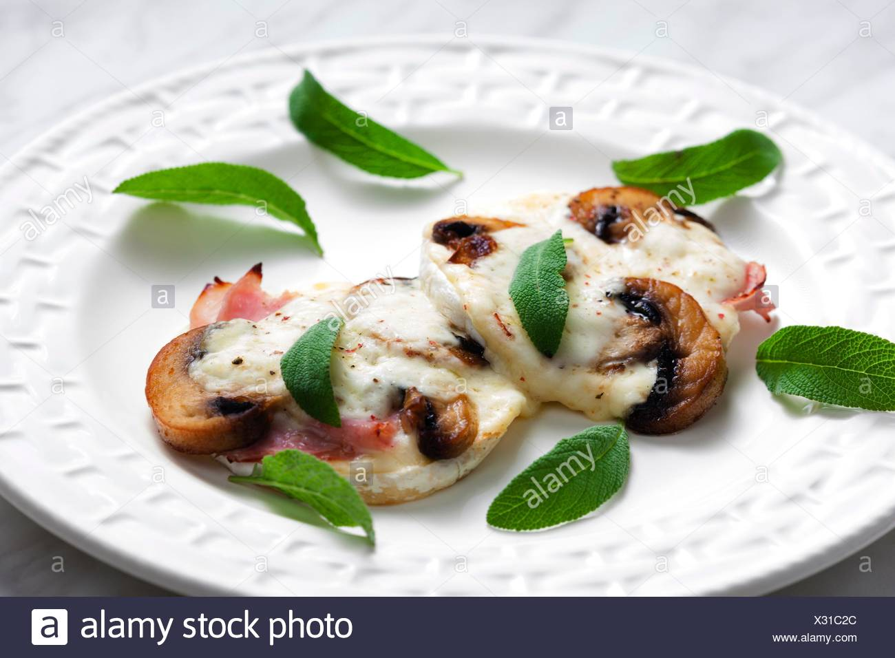 cheese brie baked with mushrooms. - Stock Image