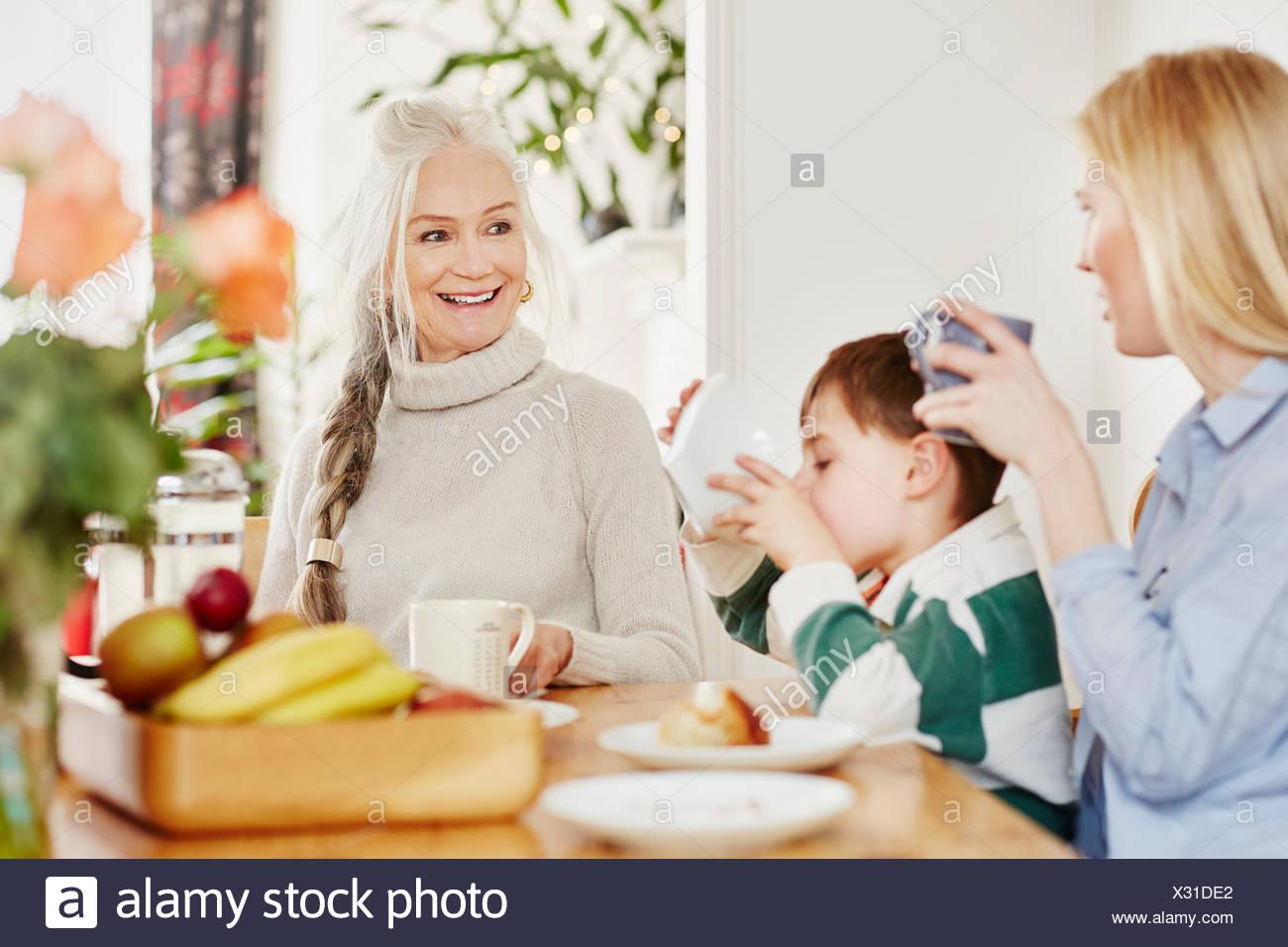 Three generation family having breakfast - Stock Image