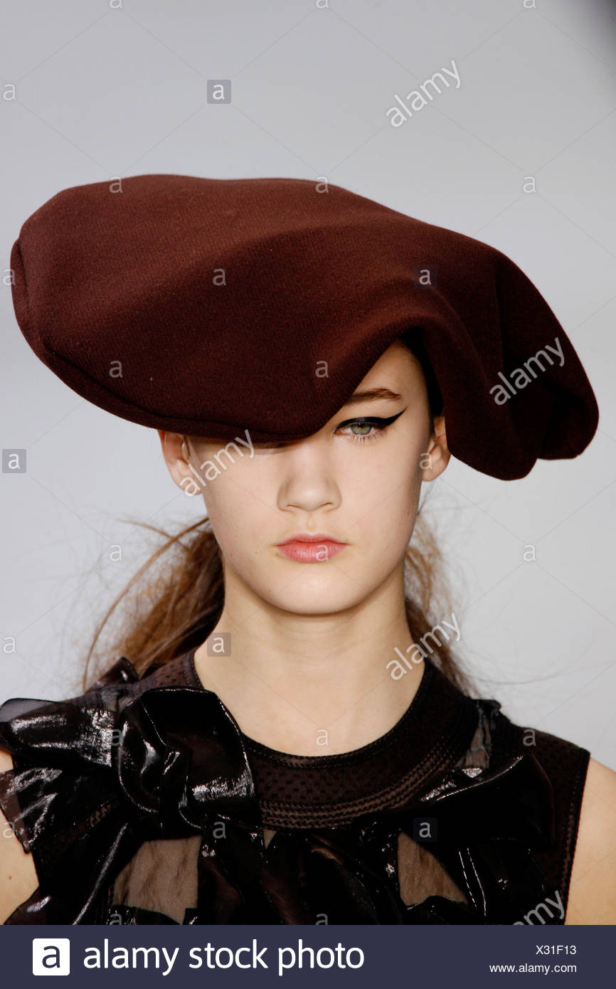 Head and shoulder female wearing brown flat beret style medieval hat -  Stock Image b1eb9358eae
