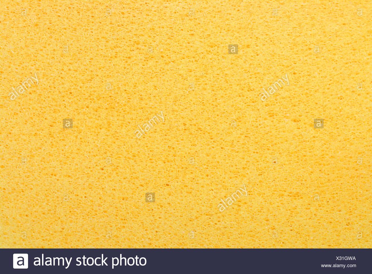 yellow porous bast whisp surface background - Stock Image
