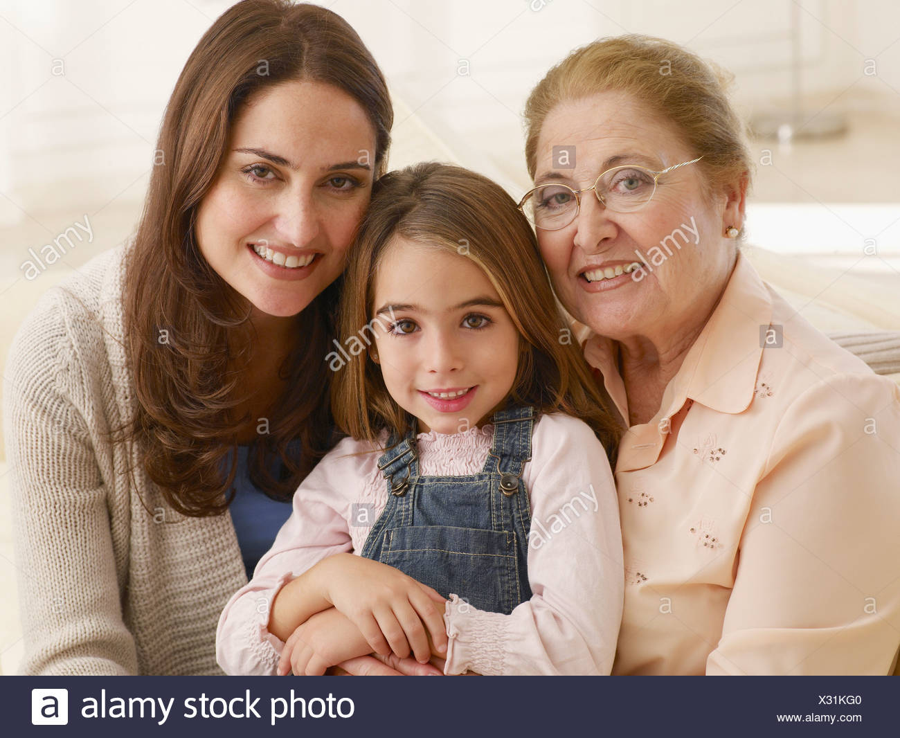 Girl posing with mother and grandmother - Stock Image