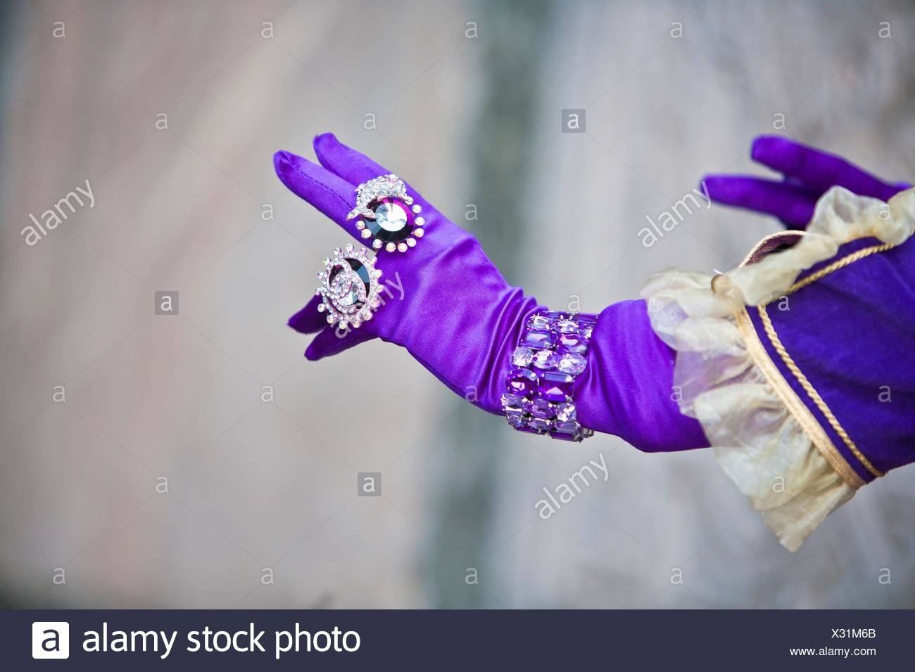 Close up of a gloved hand with rings at the carnival in Venice, Italy, Europe - Stock Image