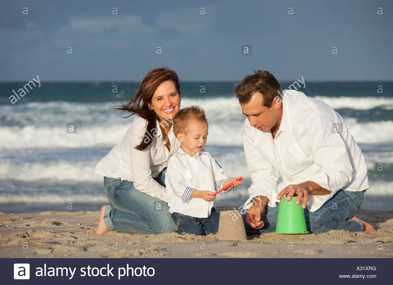 Fort Lauderdale, Florida, United States Of America; A Family Playing In The Sand On The Beach Stock Photo