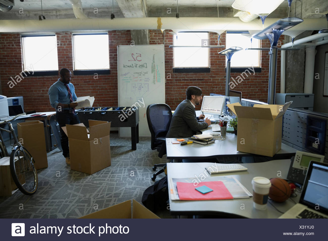 Entrepreneurs working in new office - Stock Image