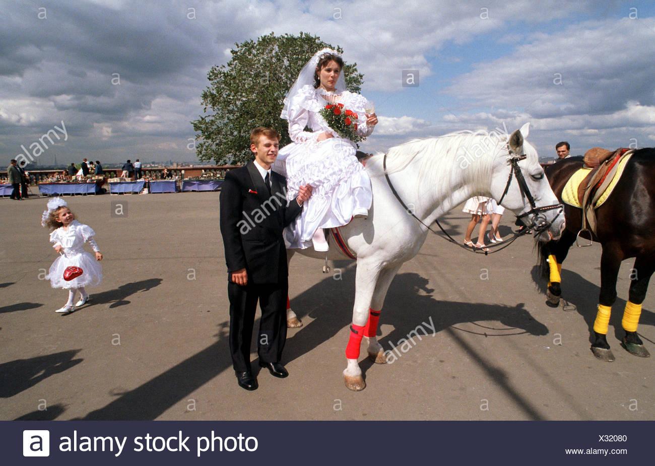 Wedding Couple Bride Sitting On A White Horse Stock Photo Alamy