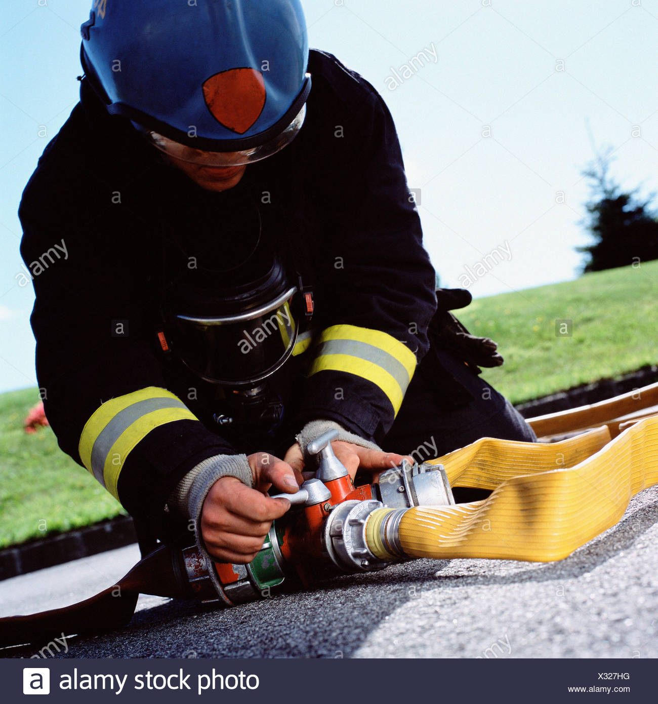 Fireman connecting hoses - Stock Image