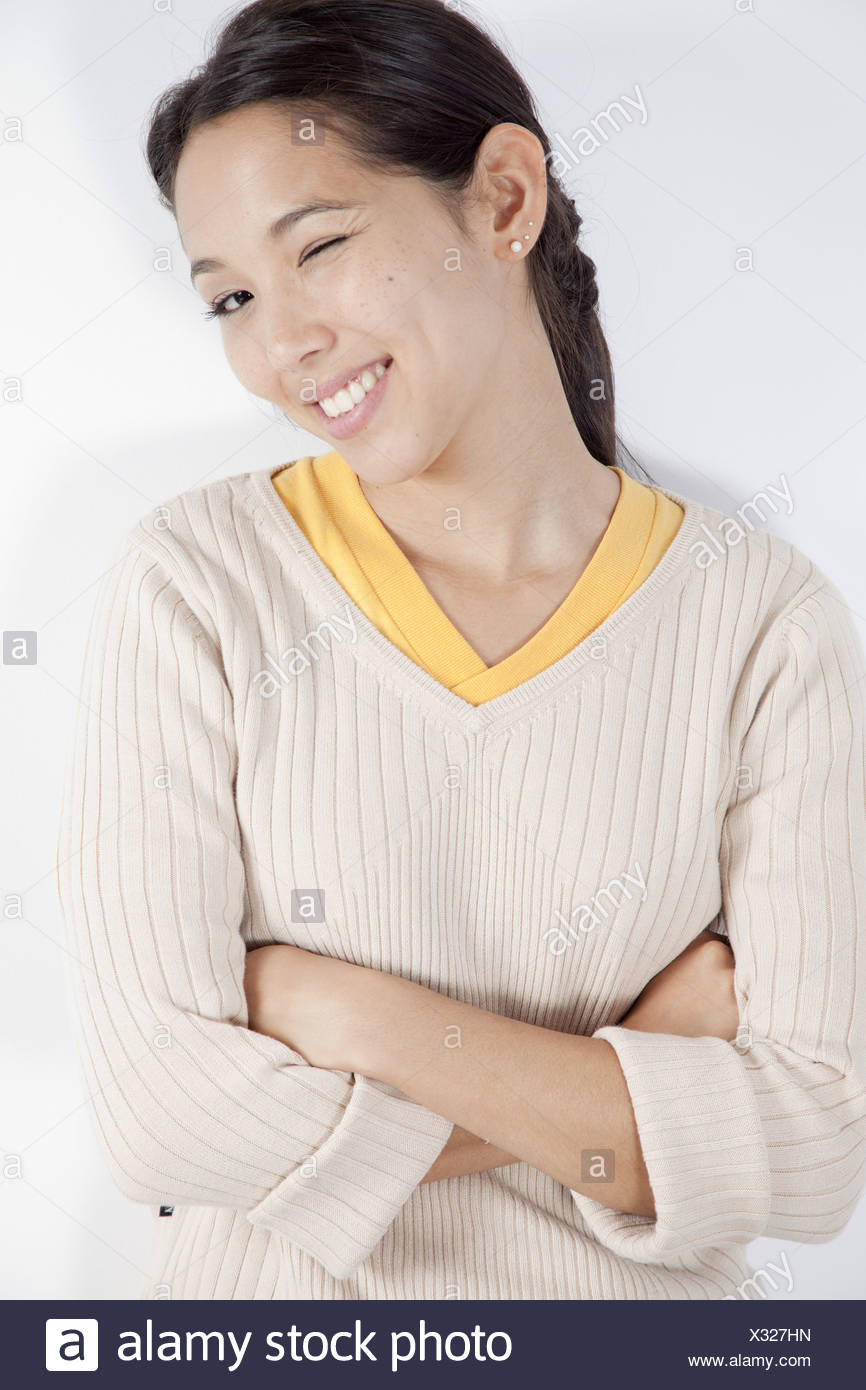 Young woman winking - Stock Image