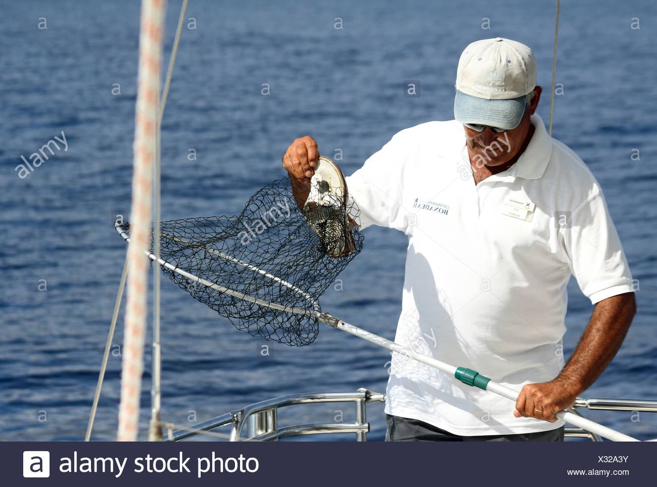 Los Cristianos, Spain, the man took a shoe from a Nets - Stock Image