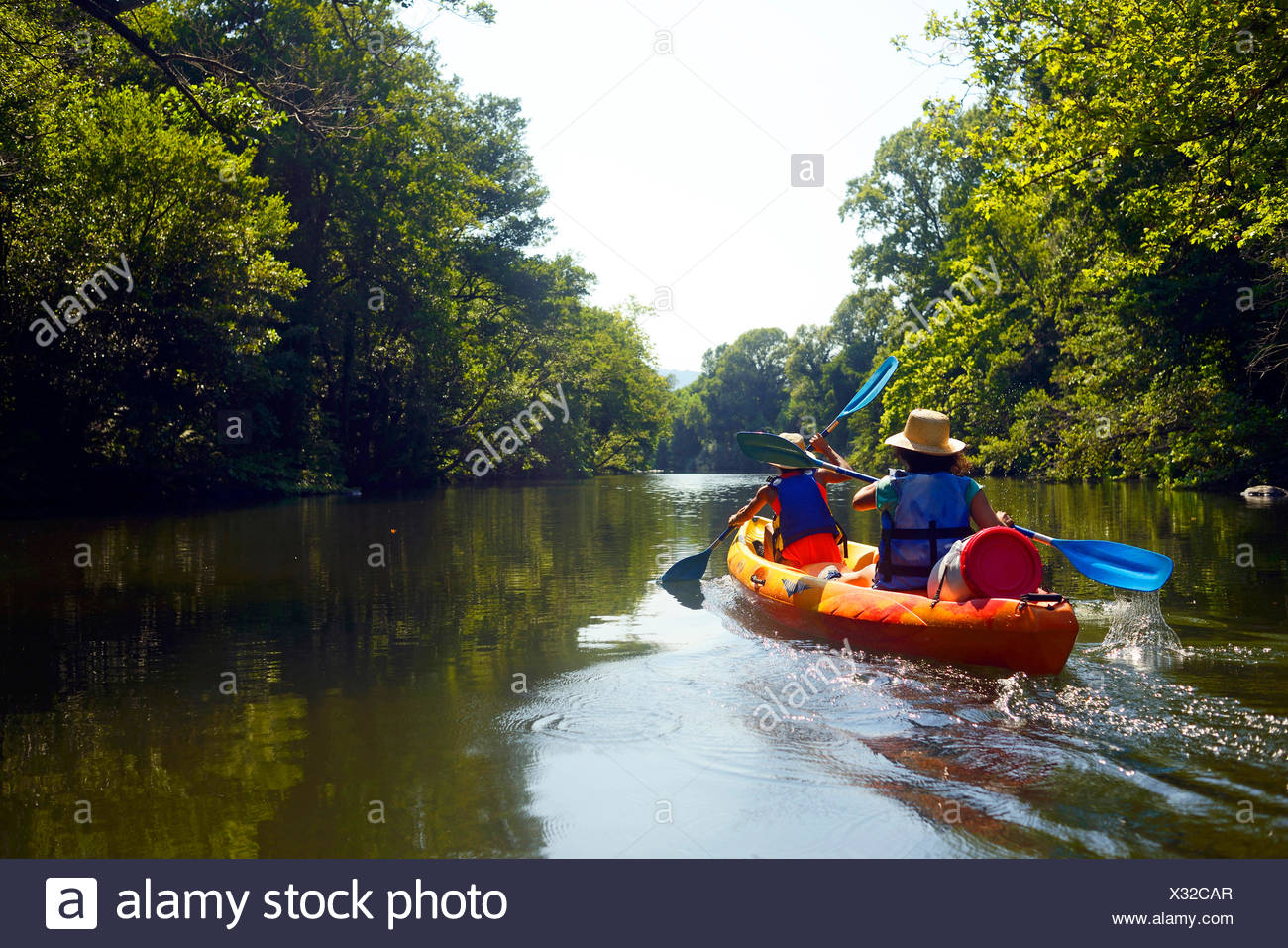 two women canoeing on the river Golo, France, Corsica, Bastia - Stock Image