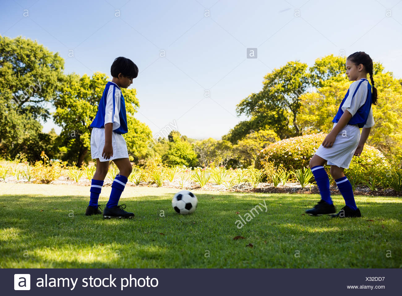 Cute football players playing football Stock Photo