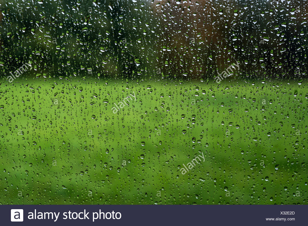 Rain streaked window looking out. - Stock Image
