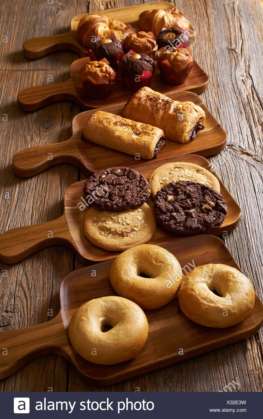 Pastries in a row Croissant Muffin Cookie Bagel and Neapolitan bakery. - Stock Image