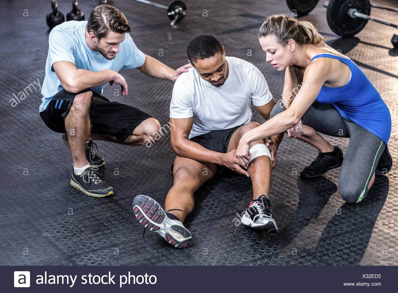 Sporty man having a muscle injury - Stock Image