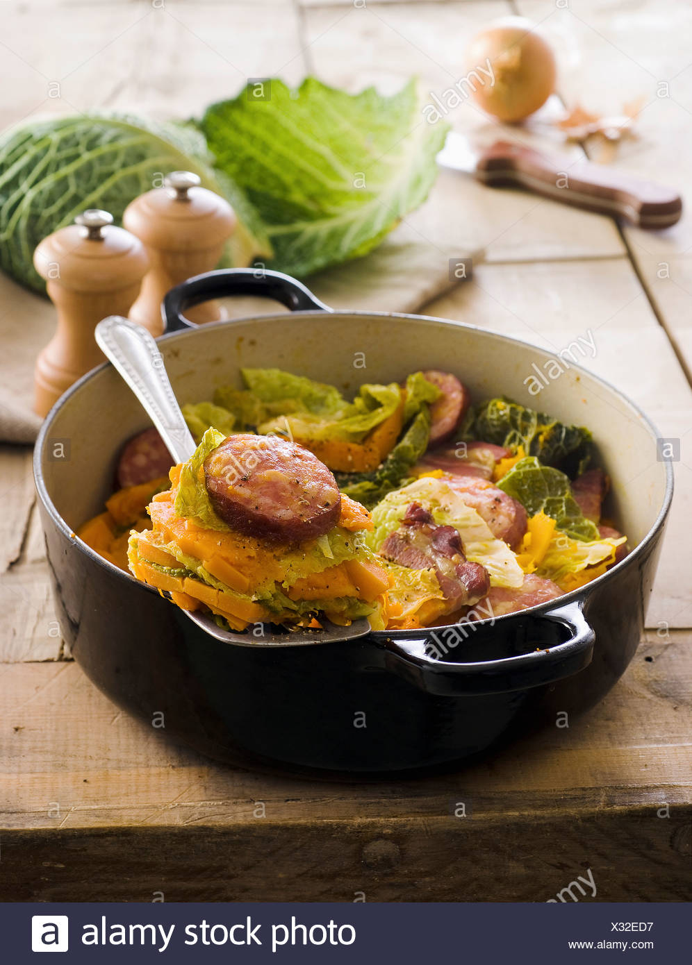 Pumpkin,cabbage and Morteau sausage hotpot - Stock Image