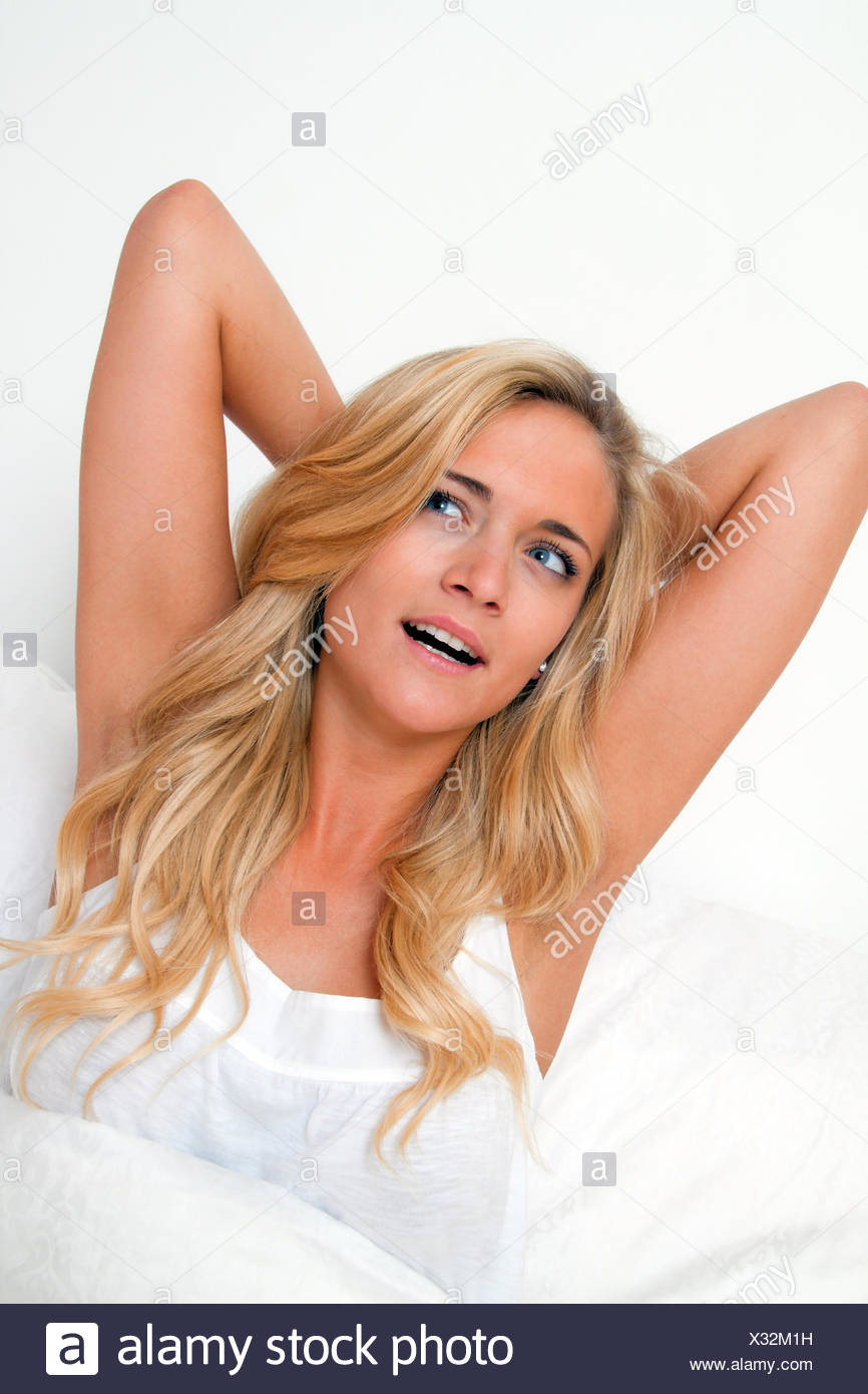 Wake up and leave. Good mood in the morning in bed Stock Photo