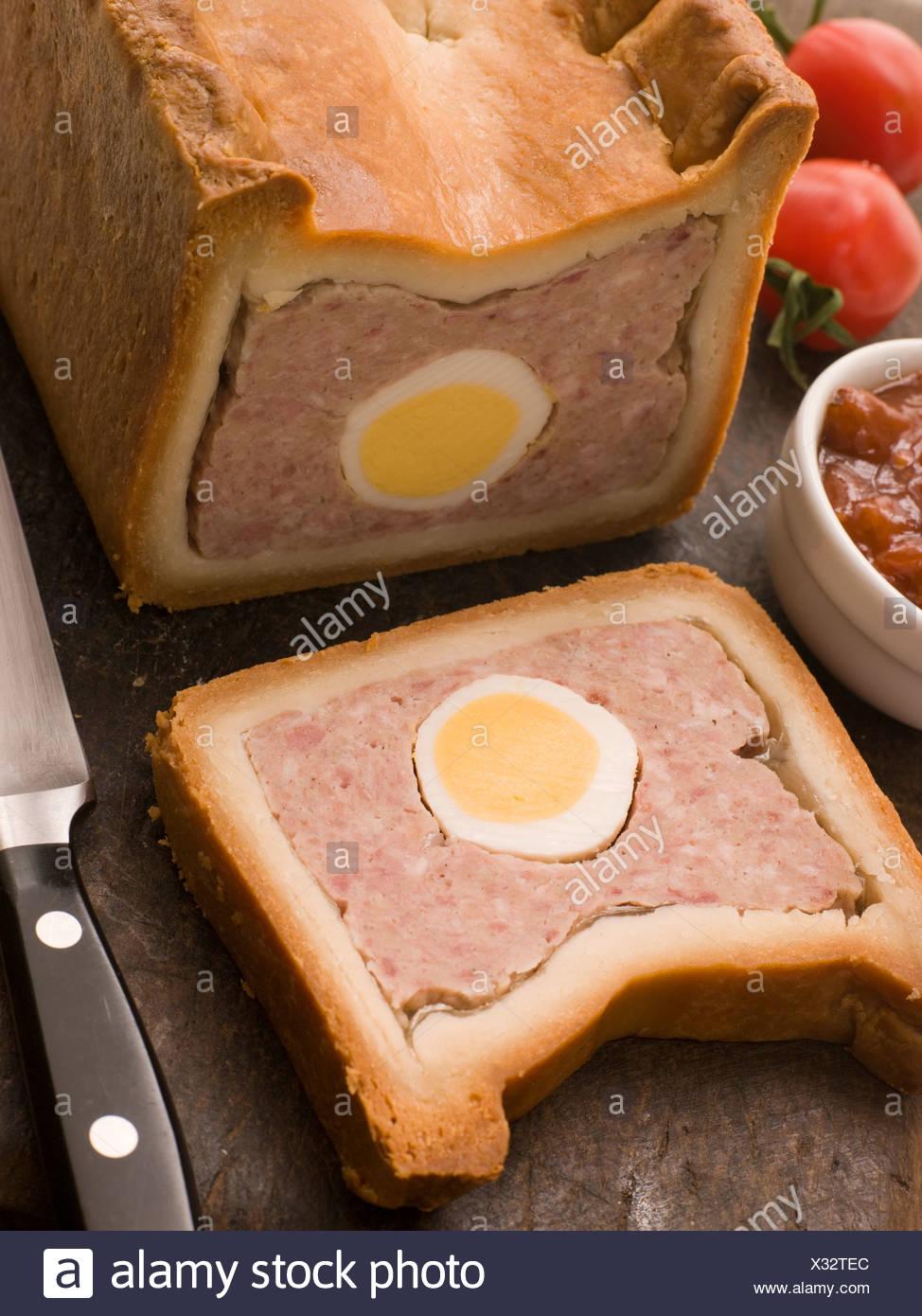 Pork and Egg Gala Pie with Tomato Chutney - Stock Image