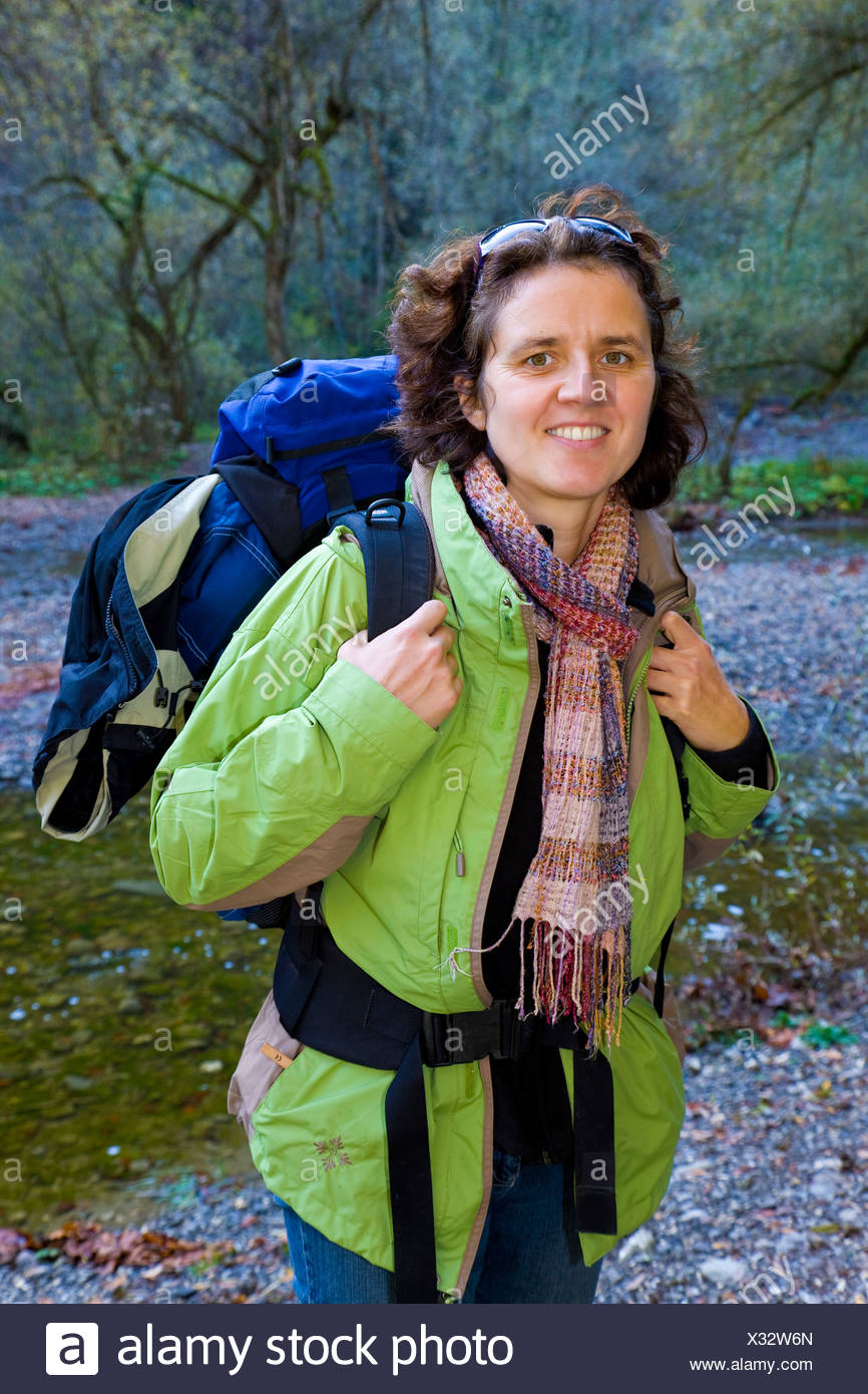 Woman, 37 years old, hiking with a backpack - Stock Image