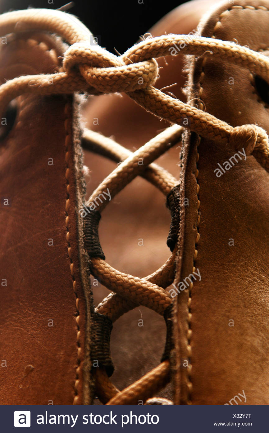 Shoe with tied laces - Stock Image