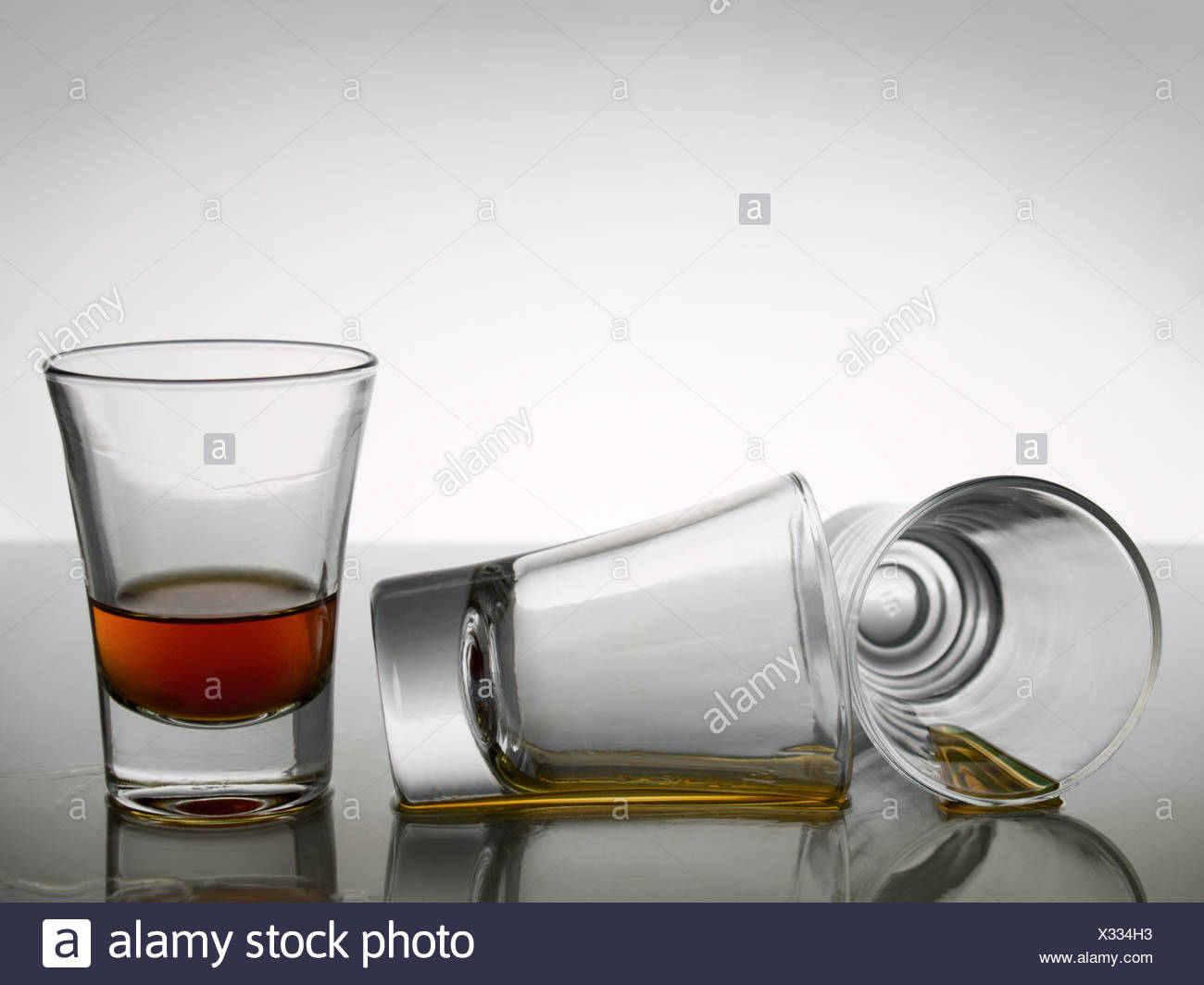 shot shots whiskey tequila lap rum close bar tavern glass chalice tumbler - Stock Image