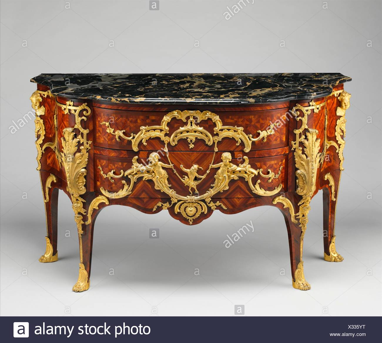 Commode. Maker: Charles Cressent (French, Amiens 1685-1768 Paris); Date: ca. 1745-49; Culture: French, Paris; Medium: Pine and oak veneered with - Stock Image
